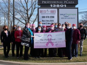 Pink Fund Check Presentation Photo